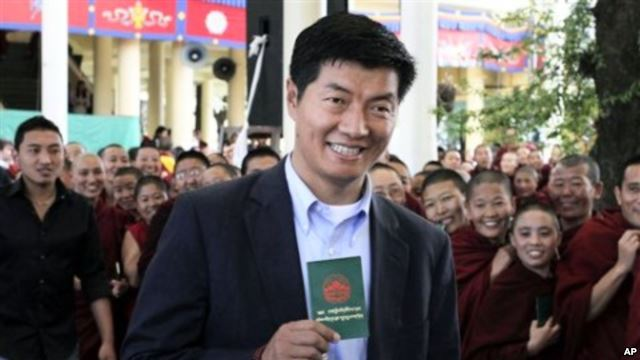 Sikyong-holding-green-book